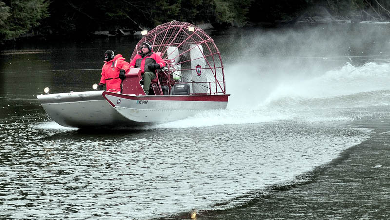 WATER SEARCH: Searchers in a Maine Warden Service airboat motor on the ice-covered Messalonskee Stream in Waterville on Monday in search of missing 20-month-old Ayla Reynolds. The search area was concentrated below the dam near Western Avenue, a short distance from Reynold's home on Violette Avenue.