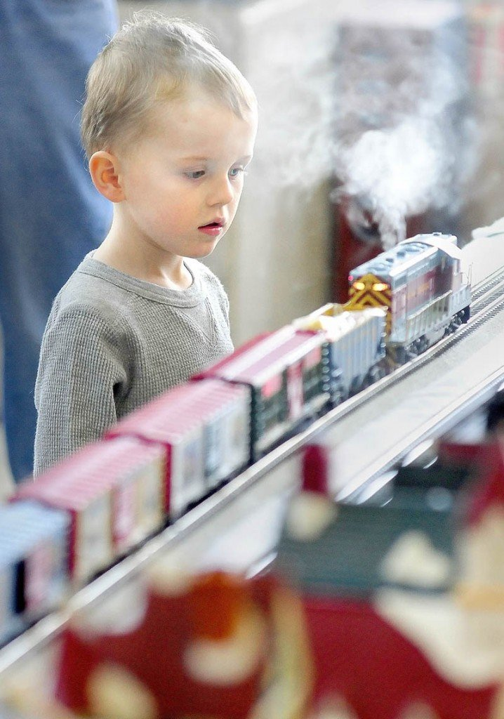THE POLAR EXPRESS: Ethan Post, 3, of Sidney, watches a smoking locomotive go past him Friday afternoon outside the Maine State Museum in Augusta. The Great Falls Model Railroad Club of Auburn and Augusta's Maine 3-Railers will display their trains in the Cultural Building atrium again from 10 a.m. to 3 p.m. today. Museum admission is free. It is located at 230 State St., beside the State House.