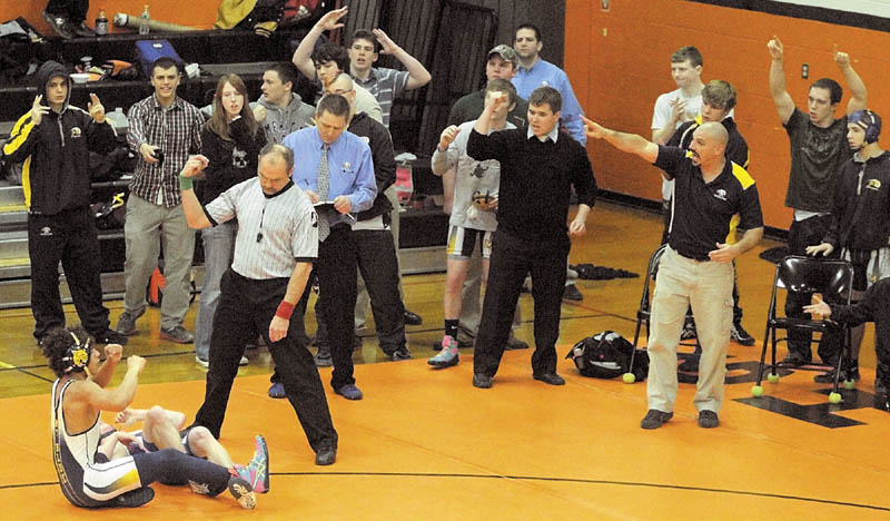THE WINNER: Mt. Blue's Khalil Newbill, bottom, left, and his Cougar teammates celebrate his overtime win over Morse's Dylan Harrington in the 120-pound finals at the Tiger Invitational on Saturday in the John A. Bragoli Memorial Gym at Gardiner Area High School.