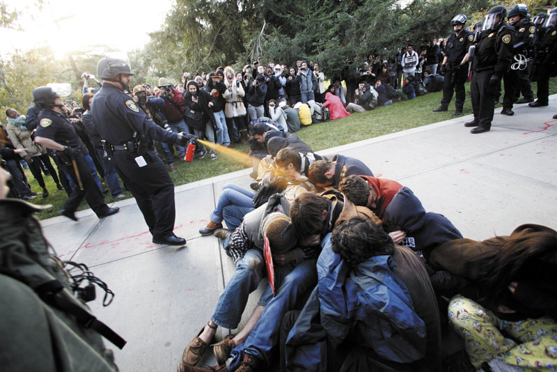 University of California, Davis, police Lt. John Pike uses pepper spray in November to move Occupy protesters while blocking their exit. Most Occupy protests across the nation have departed, but lawsuits about treatment remain.