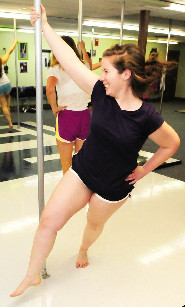 ROUND AND ROUND: Brittany Rogers circles the pole during a class on Wednesday night at Heaven-Lee Heights Inc. at 553 Maine Ave., Farmingdale.