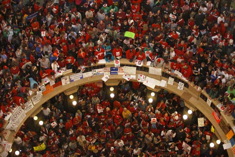 "Protestors of Wisconsin Gov. Scott Walker s bill to eliminate collective bargaining rights for many state workers pack the rotunda at the State Capitol in Madison, Wis., Thursday, Feb. 17, 2011. ""The Protestor"" was named Time's ""Person of the Year"". (AP Photo/Andy Manis)."