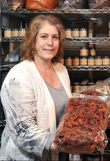 Christine Pistole displays super-hot ghost chiles available from her Gryffon Ridge Spice Merchants.