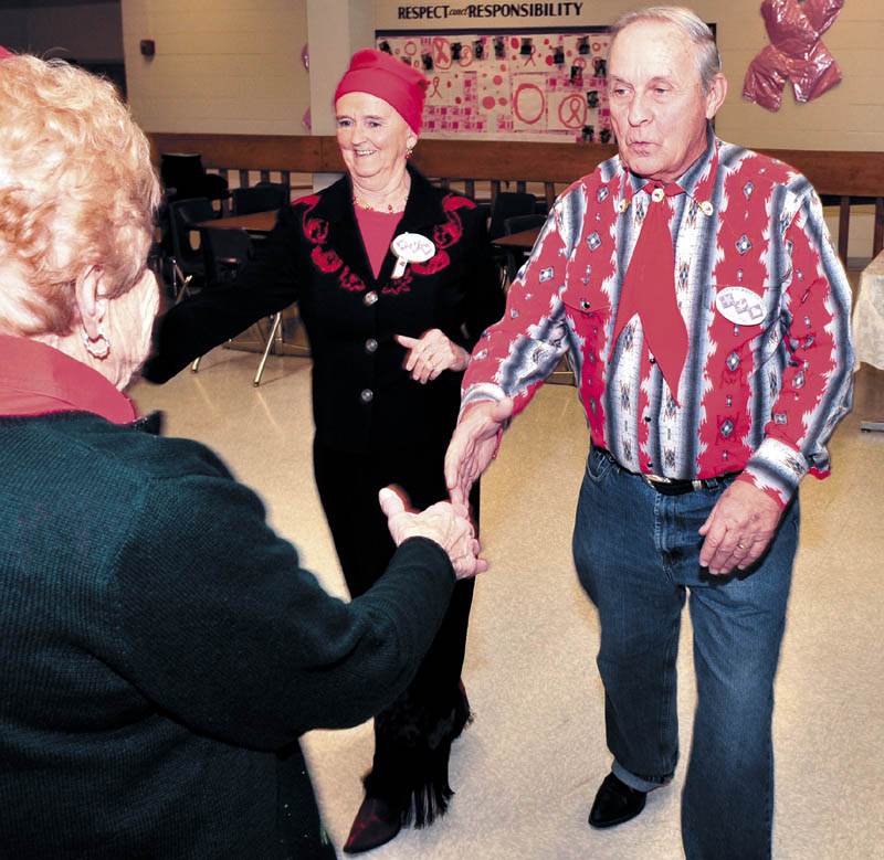 GLAD TO BE SQUARE: Carol and Eric Blier of Waterville dance with other area couples during a recent Central Maine Squares club sponsored square dance at the Waterville Junior High School.