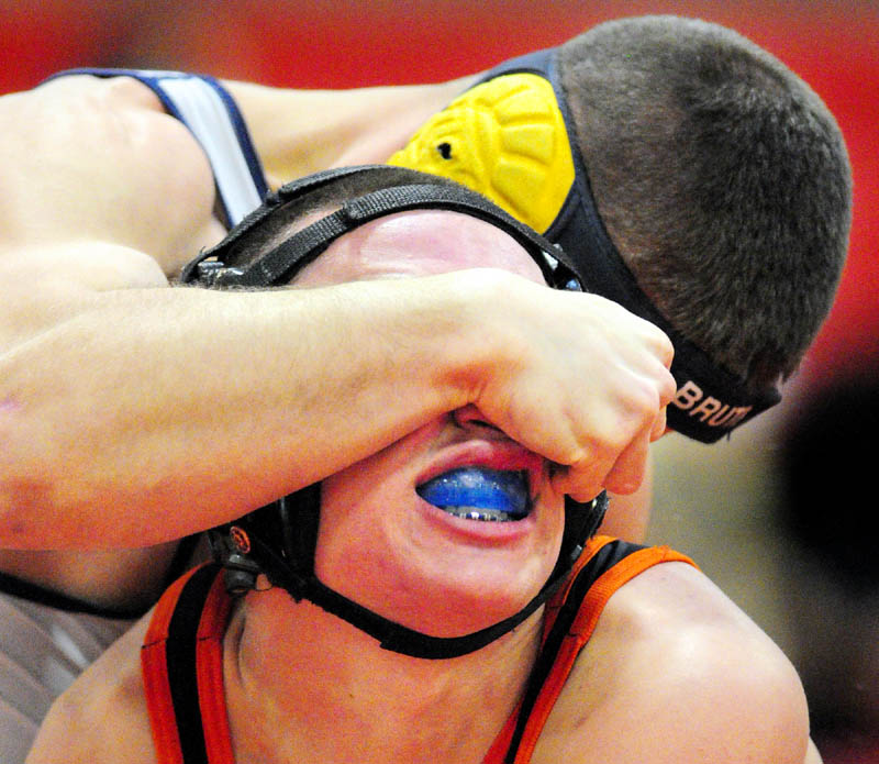 TOUGH SPOT: Mt. Blue's Chris Ingram, top, grapples with Gardiner's Wyatt Thornton in a 152-pound match during the Cony Duals on Tuesday at Cony High School in Augusta.