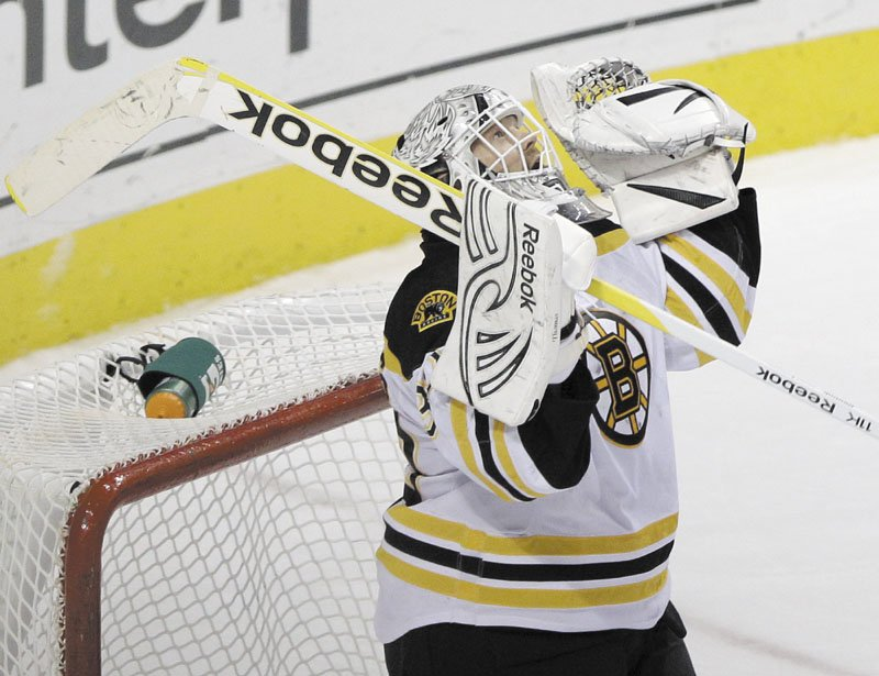 A SHUTOUT: Tim Thomas celebrates after stopping 31 shots in the Boston Bruins' 6-0 win over the Philadelphia Flyers on Saturday in Philadelphia.
