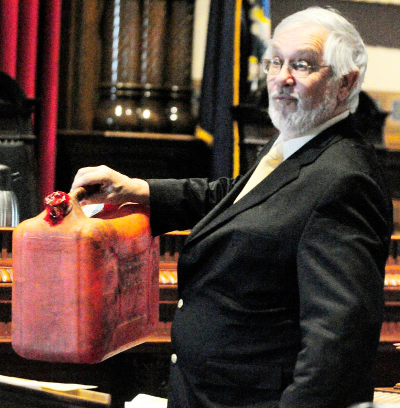 Raymond Bellavance Jr. 's defense attorney Andrews Campbell,holds up a gas can found the fire scene while he makes his closing arguments in his client's arson trial this morning in Kennebec County Superior Court in Augusta. Bellavance, 50, of Winthrop, is charged in the June 3, 2009, fire at the Grand View Topless Coffee Shop.