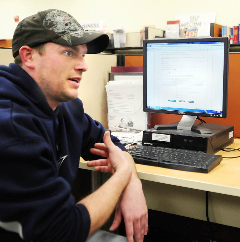 LOOKING FOR WORK: Jason Kurtz, of Sidney, answers questions during an interview on Thursday afternoon at the Augusta Career Center. Kurtz said that he is often at the center using the computers to look for a job.