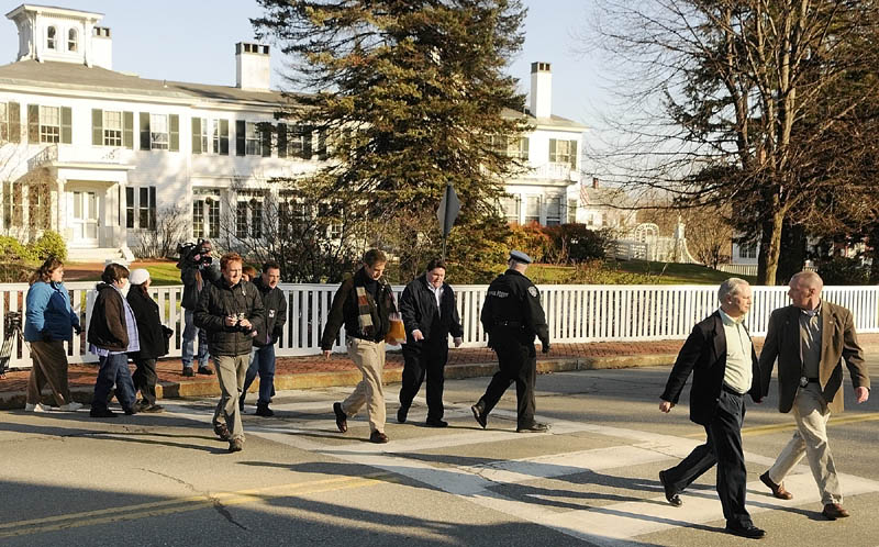 MEETING WITH THE GOVERNOR: Four members of a group protesting outside the Blaine House are escorted by law enforcement officers and Governor's Office staff across the street to meet with Gov. Paul LePage on Saturday morning in Augusta.