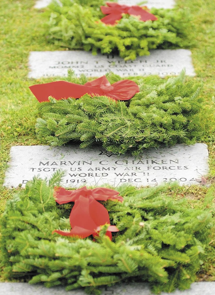 WREATHS ACROSS AMERICA: Hundreds of wreaths were laid on markers Saturday morning at the Maine Veterans' Memorial Cemetery on Mount Vernon Road in Augusta.