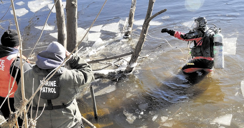 HARD SEARCH: Maine State Police diver Jarod Stedman encountered sunken wood and floating pieces of ice while searching underwater for signs of missing toddler Ayla Reynolds in the Kennebec River near the boat launch off Water Street in Waterville on Wednesday.