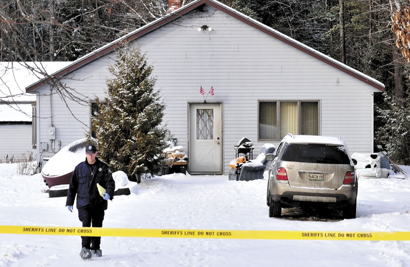 SHOOTING: Maine State Police Detective Bryant Jacques leaves the home while investigating the scene where a 22-year-old man was shot early Tuesday morning on Whitehouse Road in Vassalboro.