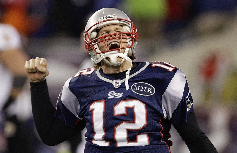 New England Patriots quarterback Tom Brady celebrates after scoring a touchdown during the second half of the AFC Championship NFL game against the Baltimore Ravens Sunday. The Patriots won, 23-20. playoff playoffs