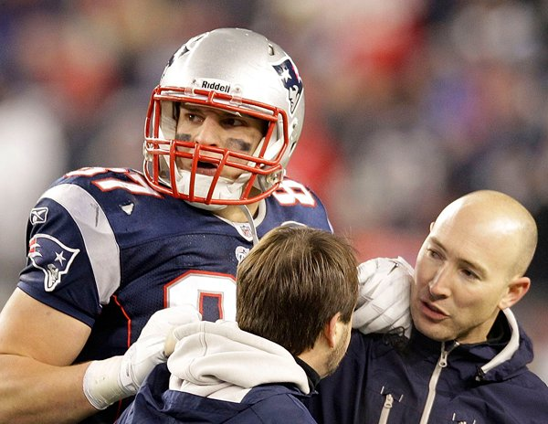 An injured Rob Gronkowski is helped off the field during the second half of the AFC Championship game against the Ravens on Sunday.