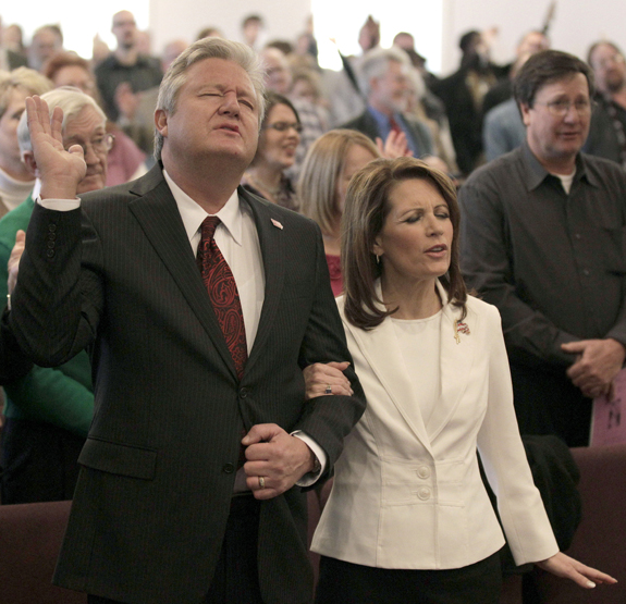Republican presidential candidate Rep. Michele Bachmann, R-Minn., and her husband Marcus attend services at Jubilee Family Church in Oskaloosa, Iowa, on Sunday.