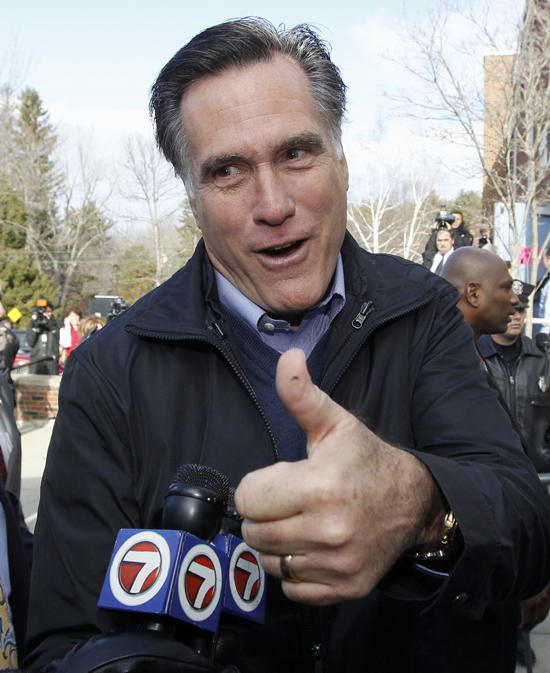 Republican presidential candidate Mitt Romney campaigns today outside a polling station in Manchester, N.H.