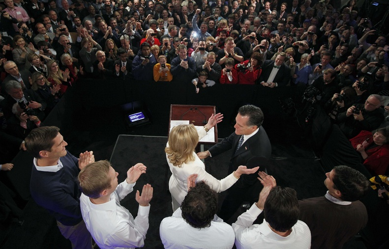 Former Massachusetts Gov. Mitt Romney reaches for his wife Ann as his sons, Josh, Ben, Craig, Tagg and Matt, left to right, applaud during the Romney for President rally at Southern New Hampshire University in Manchester, N.H., on Tuesday, when Romney won the state's GOP primary.