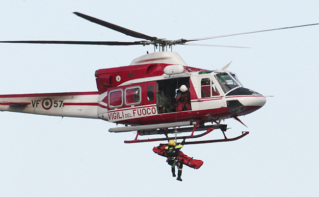 A firefighter helicopter lifts up a person from the luxury cruise ship Costa Concordia on Sunday.