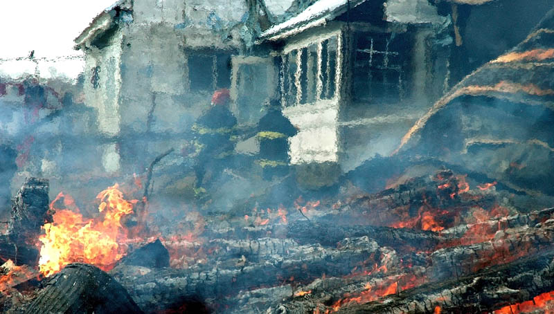 Firefighters from several towns battled a blaze Thursday morning on Brighton Road, Route 151, that destroyed a large barn and part of the adjoining farm house. The residents said they were insured.