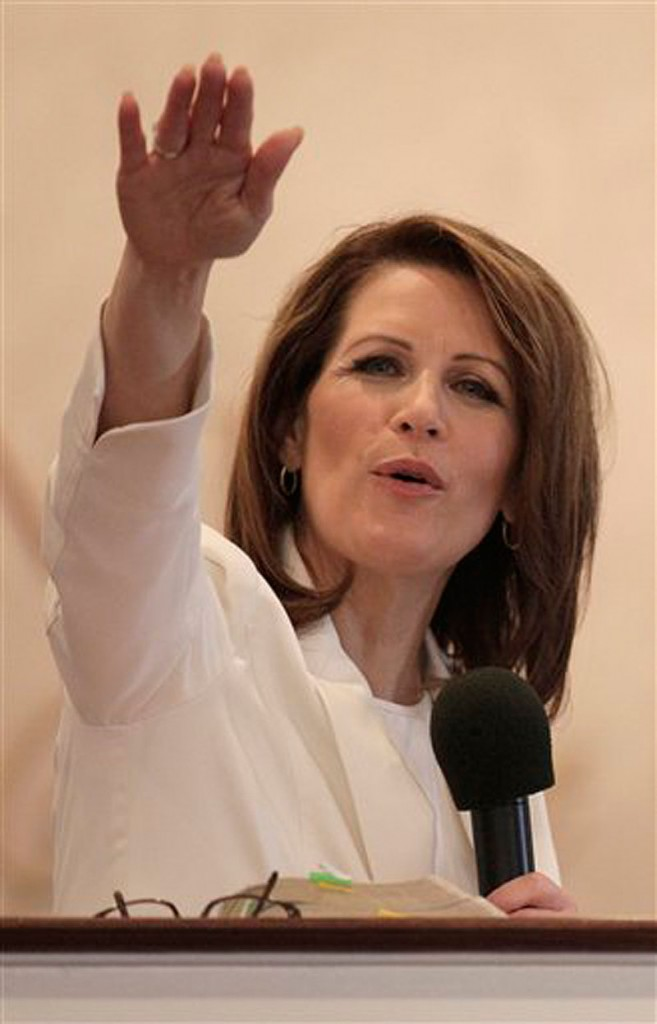 In this Jan. 1, 2012 photo, Rep. Michele Bachmann, R-Minn., speaks at Jubilee Family Church in Oskaloosa, Iowa. Bachmann told The Associated Press on Wednesday she'll seek a 4th term in Congress. (AP Photo/Charlie Riedel)