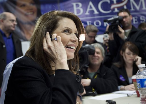 Republican presidential candidate Rep. Michele Bachmann, of Minnesota, makes phone calls during a stop at her campaign headquarters on Saturday, Dec. 31, 2011, in Urbandale, Iowa. (AP Photo/Evan Vucci)