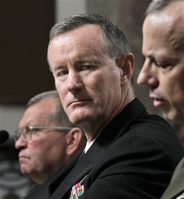 Navy Vice Adm. William H. McRaven, center, is seen on Capitol Hill in Washington. As traditional military operations are cut back, the Pentagon is moving to expand the worldwide reach of the U.S. Special Operations Command to strike back wherever threats arise. U.S. officials say the Pentagon and the White House have embraced a proposal by special operations chief Adm. Bill McRaven to push troops that are withdrawing from war zones to reinforce special operations units in areas somewhat neglected during the decade-long focus on al-Qaida. At left is Gen. James D. Thurman, nominee to become commander of U.S. forces in Korea. (AP Photo/J. Scott Applewhite)
