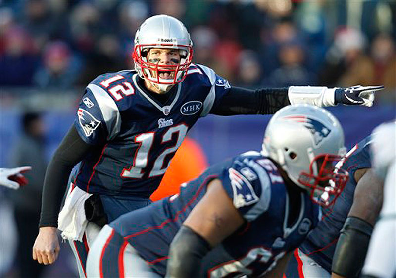 New England Patriots quarterback Tom Brady yells before the snap against the Miami Dolphins during a December game at Gillette Stadium in Foxborough, Mass. (AP Photo/Charles Krupa)
