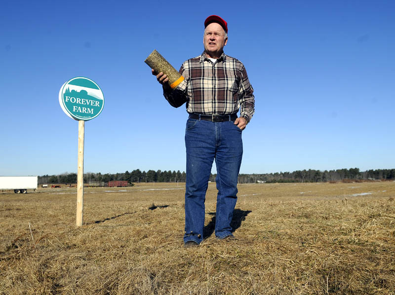 Vassalboro farmer Peter Bragdon hopes to preserve farmland by producing logs from hay for home heating use.