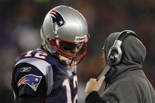 New England Patriots quarterback Tom Brady (12) talks to head coach Bill Belichick during the second half of an NFL divisional game against the Denver Broncos on Saturday in Foxborough, Mass. playoff playoffs