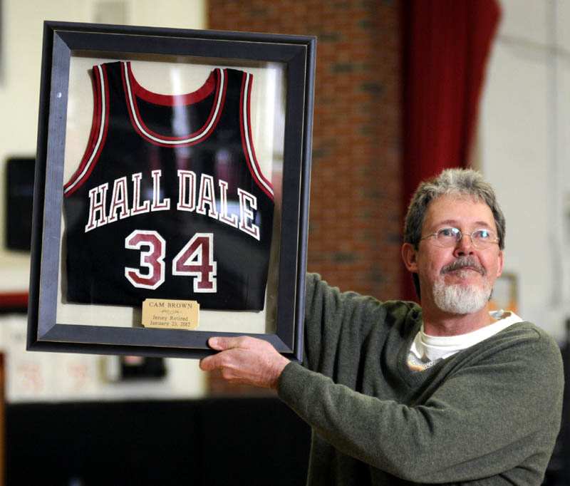 HONORED: Cam Brown holds his Hall-Dale High School basketball jersey Monday after it was retired at the Farmingdale school.