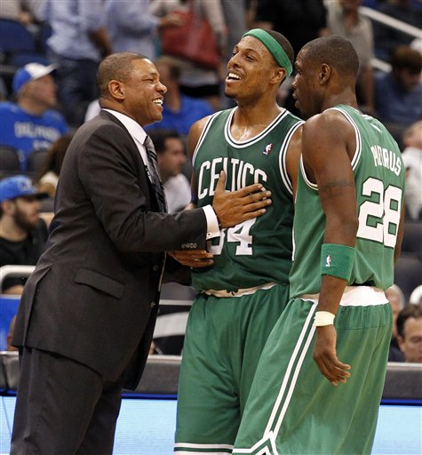 Boston Celtics coach Doc Rivers, left, celebrates with Paul Pierce and Mickael Pietrus during the second half Thursday in Orlando, Fla. The Celtics won 91-83.