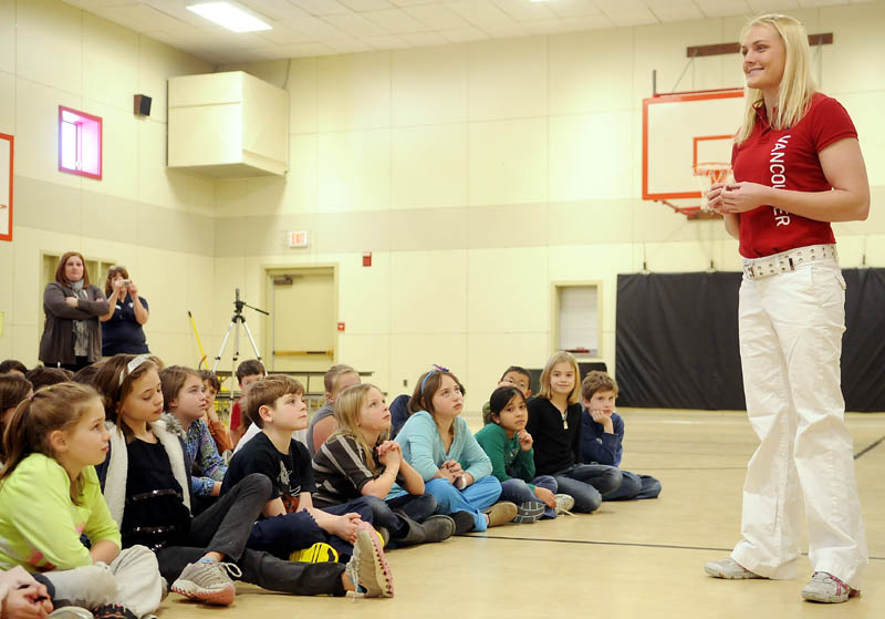 ON TRACK: Julia Clukey, of Augusta, discusses competing in Olympic luge Wednesday at Manchester Elementary School. Clukey announced at the event the formation of an athletic camp for girls to be held this summer at the YMCA camp that she will host.