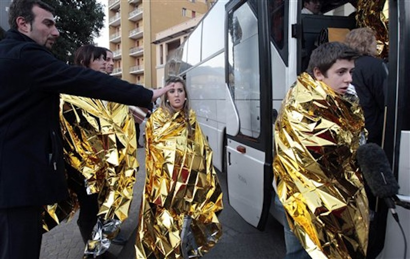 Passengers of the luxury ship that ran aground off the coast of Tuscany board a bus in Porto Santo Stefano, Italy. (AP Photo/Gregorio Borgia)