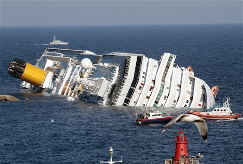 The luxury cruise ship Costa Concordia lays on its side after running aground the tiny Tuscan island of Giglio, Italy. (AP Photo/Gregorio Borgia)