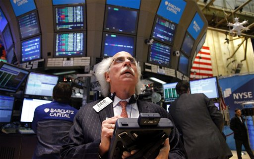 Peter Tuchman, a trader with Quattro M Securities, works from a handheld computer during the first day of trading at the New York Stock Market on Tuesday, Jan. 3, 2012. The Dow Jones industrial average soared 200 points, or 1.7 percent, to 12,423 in the first minutes of trading Tuesday. (AP Photo/Bebeto Matthews)
