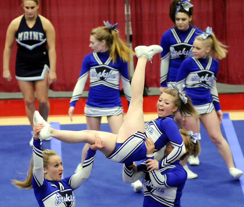 CATCH ME: The Erskine Academy cheerleaders compete in the Kennebec Valley Athletic Conference cheering championship Monday in Augusta. The Eagles finished in 11th place in Class A.