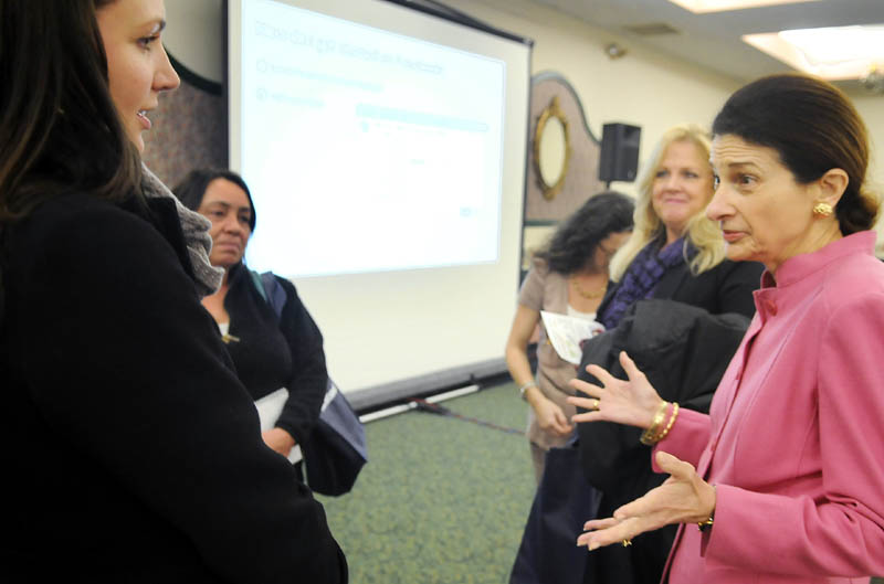U.S. Senator Olympia Snowe, R-Maine, right, confers Tuesday with Laura Kibort, left, during an Augusta forum held by Facebook to assist small business to utilize the social networking site. Kibort is the event manager of the Royal Oak Room in Lewiston.