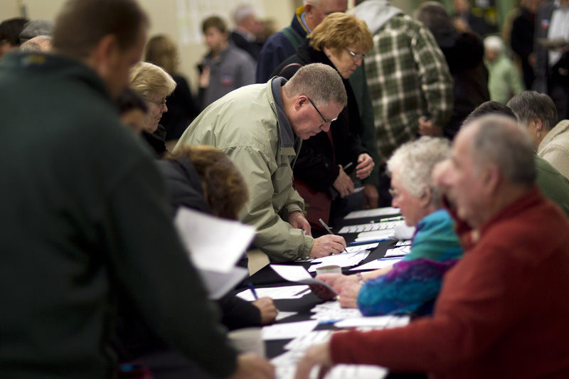 Voters sign in to caucus at Point of Grace Church tonight in Waukee, Iowa.