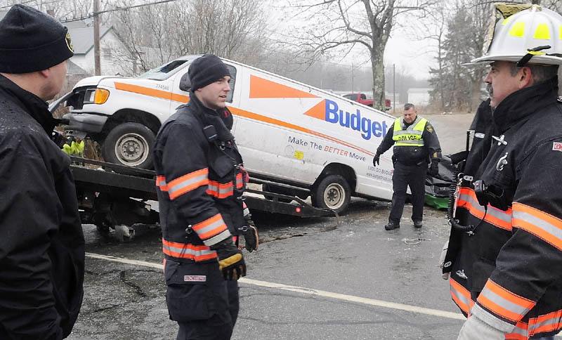 TWO DEAD IN ACCIDENT: Gardiner police and firefighters remove a van that rolled over Saturday morning and claimed the lives of two men and injured a third on the ice-covered U.S. Route 201 in Gardiner. The accident occurred after 8 a.m., according to Gardiner Police Chief James Toman.