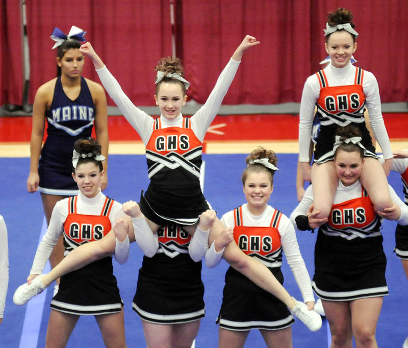 HERE WE COME: The Gardiner Area High School cheerleaders perform a stunt in the Kennebec Valley Athletic Conference cheering championship Monday in Augusta. The Tigers finished sixth in Class B.