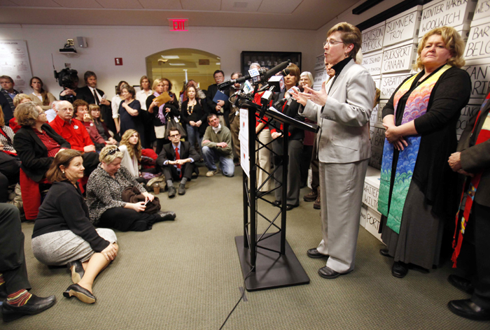 """Betsy Smith, executive director of EqualityMaine, speaks at the State House news conference Thursday. """"This denial of marriage continues to be a very painful part of our lives. The need for marriage has not gone away since 2009,"""" she said."""