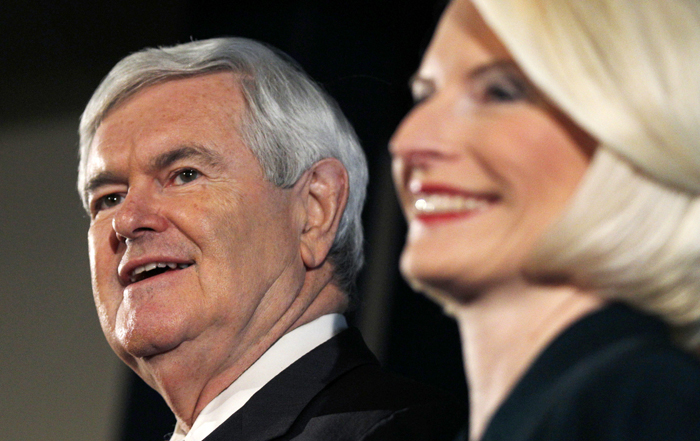 Republican presidential candidate Newt Gingrich, accompanied by his wife Callista, makes a campaign stop in Manchester, N.H., today.