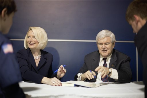 Republican presidential candidate Newt Gingrich and his wife Callista sign autographs Friday at a campaign rally aboard the USS Yorktown in Mt. Pleasant, S.C.
