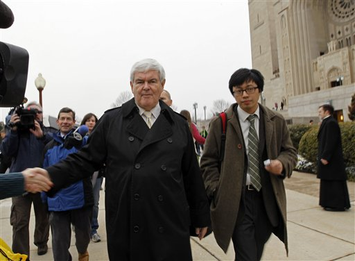 Newt Gingrich is greeted by supporters after Mass at the Basilica of the National Shrine in Washington on Sunday.