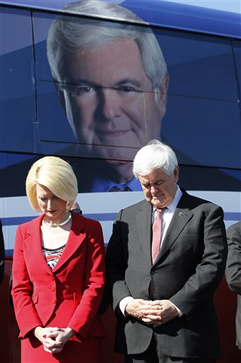 Newt Gingrich, with his wife Callista, bow their heads in prayer during a campaign event in Lady Lake, Fla., on Sunday.