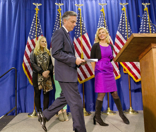 Former Utah Gov. Jon Huntsman steps to the podium today to announce his withdrawal from the presidential race and endorsement for former Massachusetts Gov. Mitt Romney, as wife Mary Kaye, right, and daughter Elizabeth, left, look on.