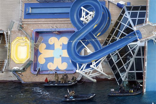 Italian Navy scuba divers work next to the cruise ship Costa Concordia off the island of Giglio on Sunday.