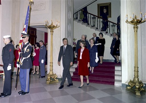 This Nov. 20, 1963, photo released by the John F. Kennedy Presidential Library and Museum in Boston, shows President John F. Kennedy, First Lady Jacqueline Kennedy, Chief Justice Earl Warren, Mrs. Warren, and others descending the Grand Staircase during the Judicial Reception at the White House.