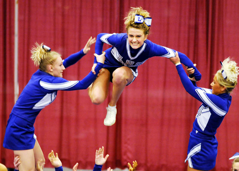 UP, UP AND AWAY: The Lawrence High School cheerleaders compete on their way to a fourth-place finish at the Kennebec Valley Athletic Conference Class A Cheerleading Championship on Monday at the Augusta Civic Center.