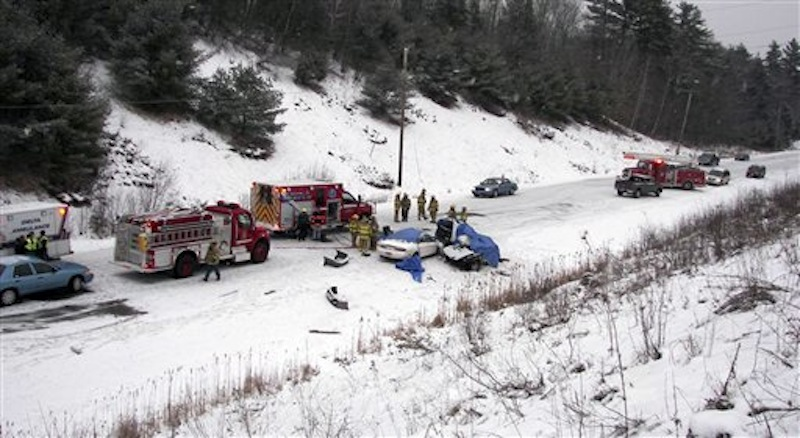 In this Dec. 25 photo, emergency personnel respond to a two-vehicle crash in Palermo, Maine, where four men died in the accident. Officials said the number of highway deaths dipped to the lowest level in more than six decades in Maine and to an all-time low in neighboring New Hampshire in 2011. (AP Photo/Maine State Police, File)